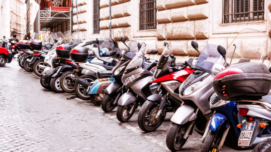 ROME, ITALY - OCTOBER 29: Citizens most commonly use motorcycles for everyday transportation in Rome Italy on October 29, 2014.