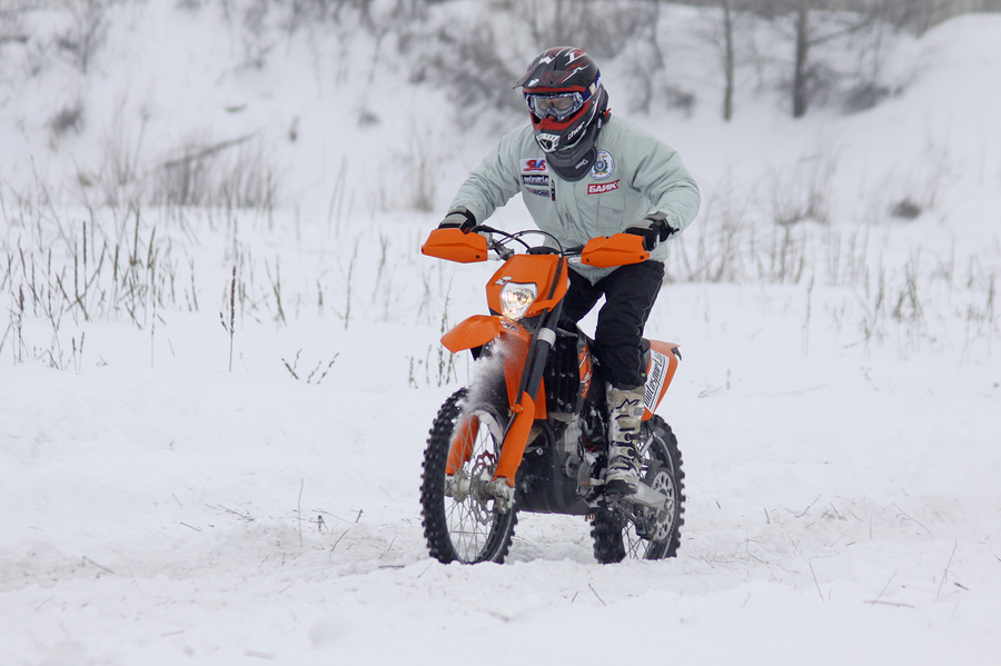 KYIV UKRAINE - 13 FEBRUARY 2010: The moto bike's driver Dmytro Voloshko (KTM 450 EXC-R) ride over snow track during Baja Kyiv-2010 Rally on 13 Feb 2010 in Kyiv